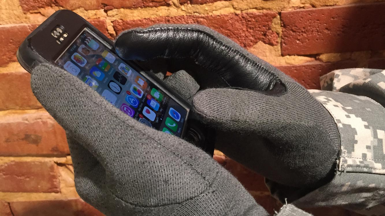 ROG First Contact Glove with iPhone on Brick Wall